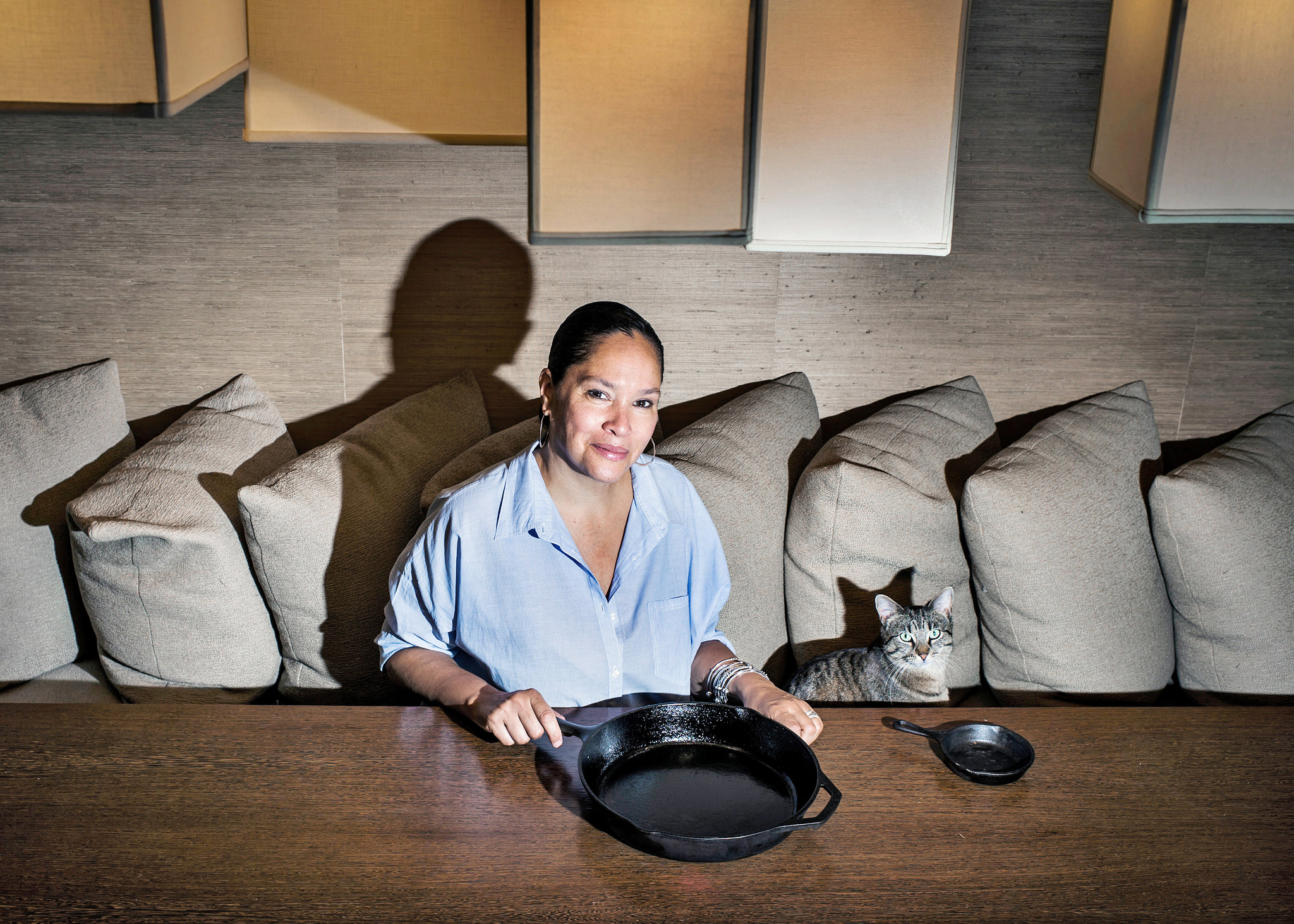 Jocelyn Cooper and her cat (Dina Litovsky for the New York Times).