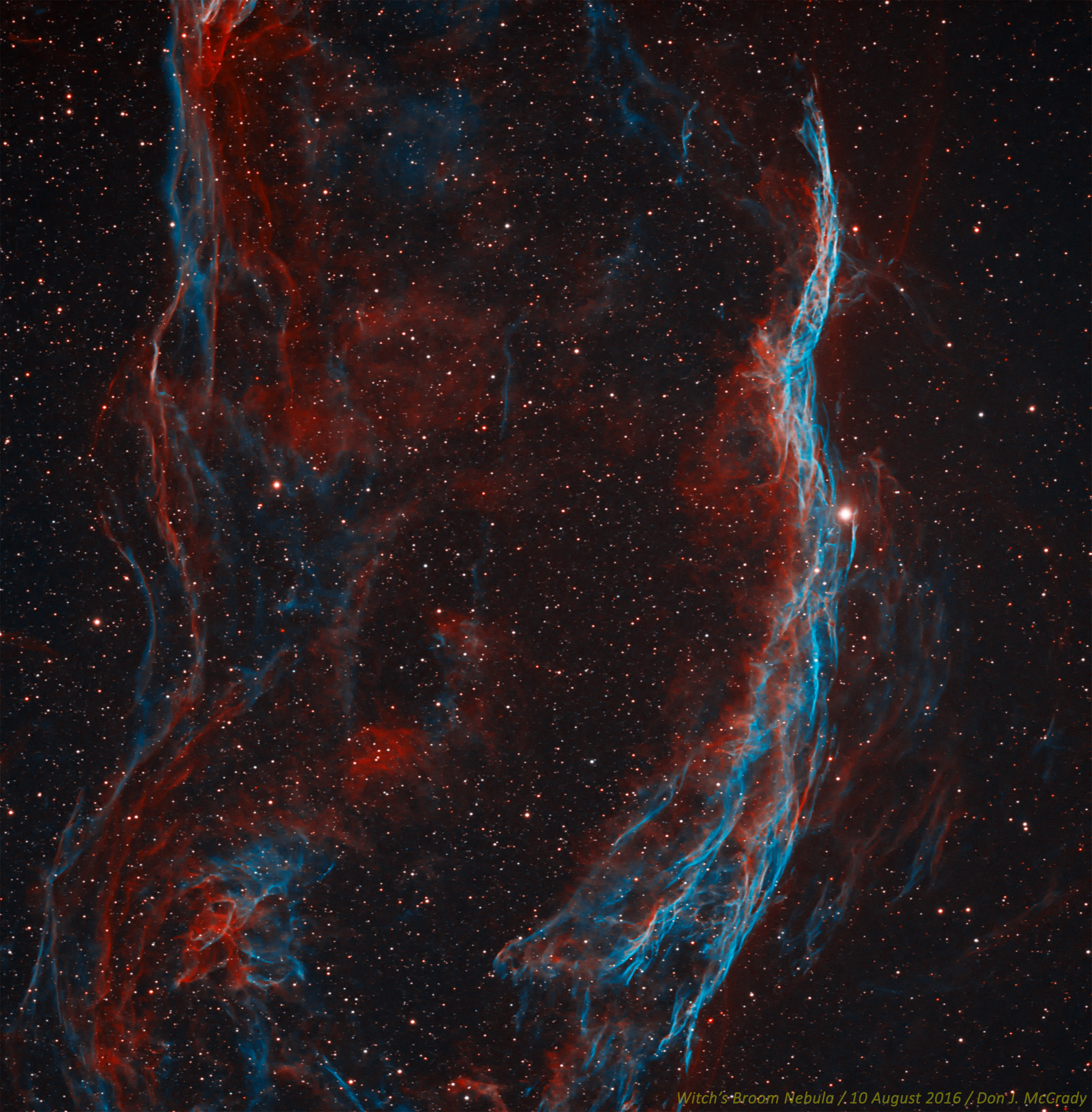 The Witch's Broom Nebula is also part of the famous Veil Nebula complex, this being the western portion. The entire complex is the remnant of a powerful supernova explosion which occurred thousands of years ago, sending elements forged in the destroyed stars core into space. The bright star is 52 Cygni. Hydrogen-alpha was used as the red channel, while Oxygen-III was used as the blue and green channels. Taken with a Stellarvue SVS130 and STL-4020M. Processed in MaximDL and Photoshop, and upsampled 1.5x.